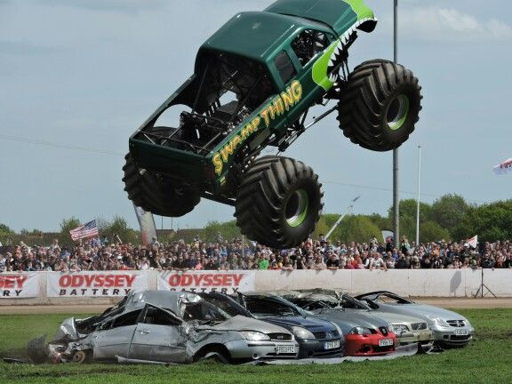 Swamp Thing Monster Truck Catching Some Air Crushing Some Cars