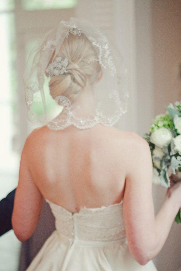 a shoulder-grazing embellished veil  Photography by jnicholsphoto.com