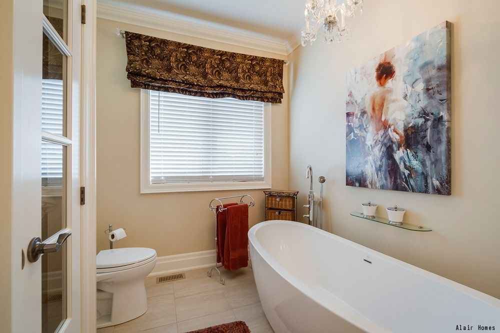 A transitional style bathroom with a white free standing