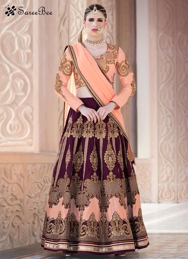 13c2afddc2 Angelic Peach And Wine Lehenga Choli Add a small burst of shade to the  wardrobe with this peach and wine banglori silk lehenga choli.