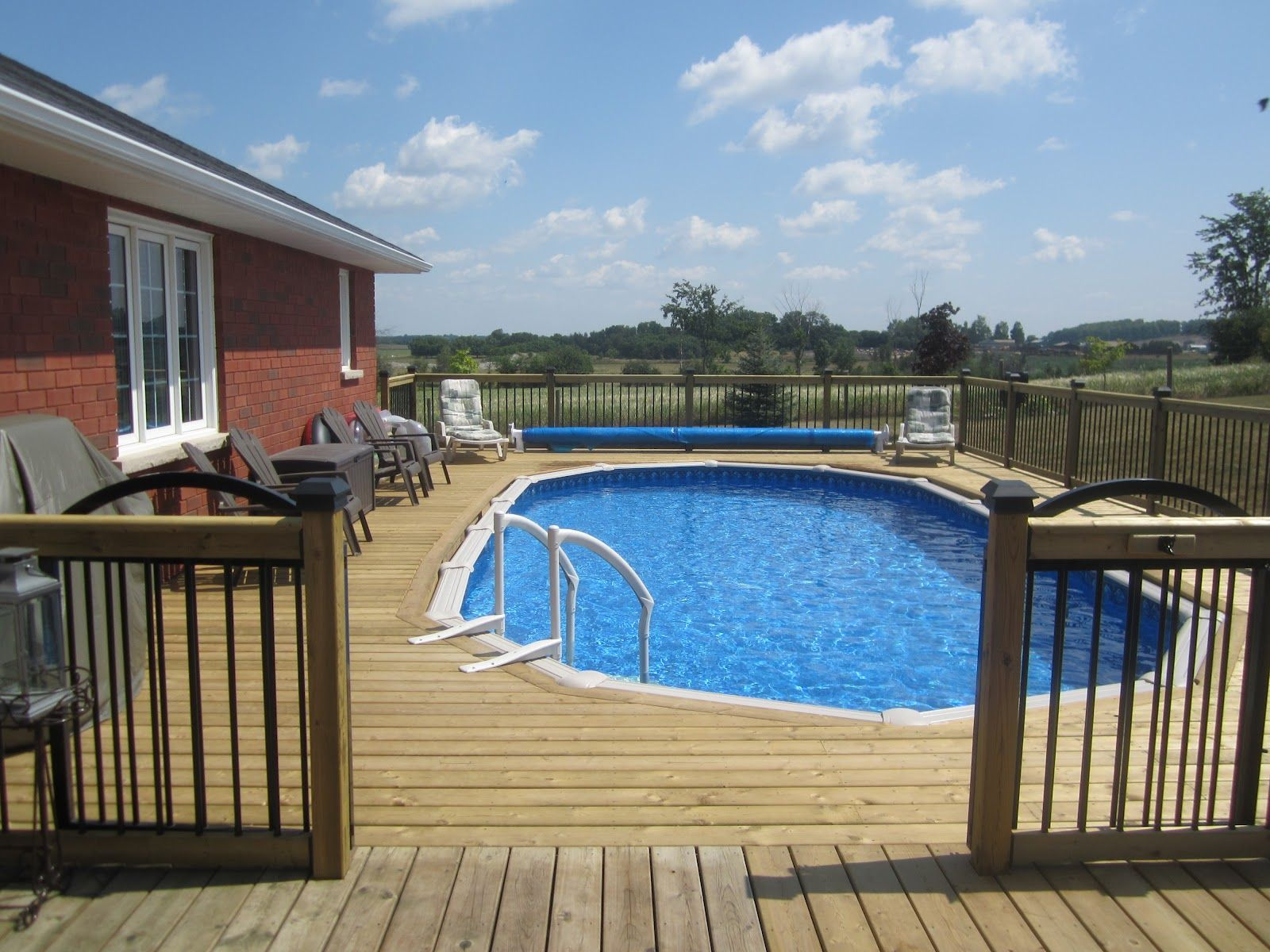 Decks built off back of house with above ground pool for Deck from house to above ground pool