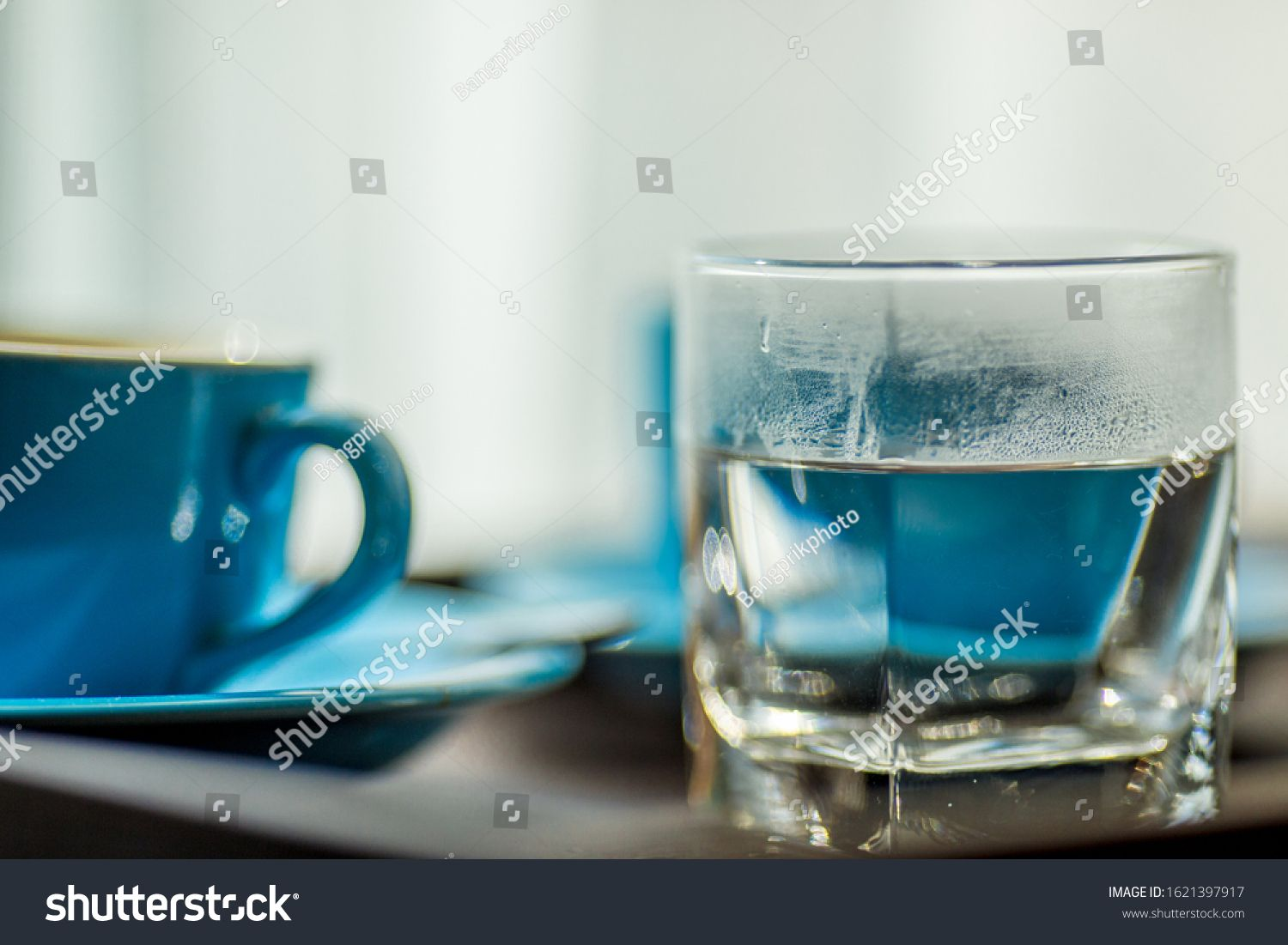 Blurred background view of a mug or coffee cup, a cup of water or a drink on the table, for customer service in a room or restaurant #Sponsored , #spon, #mug#coffee#cup#Blurred