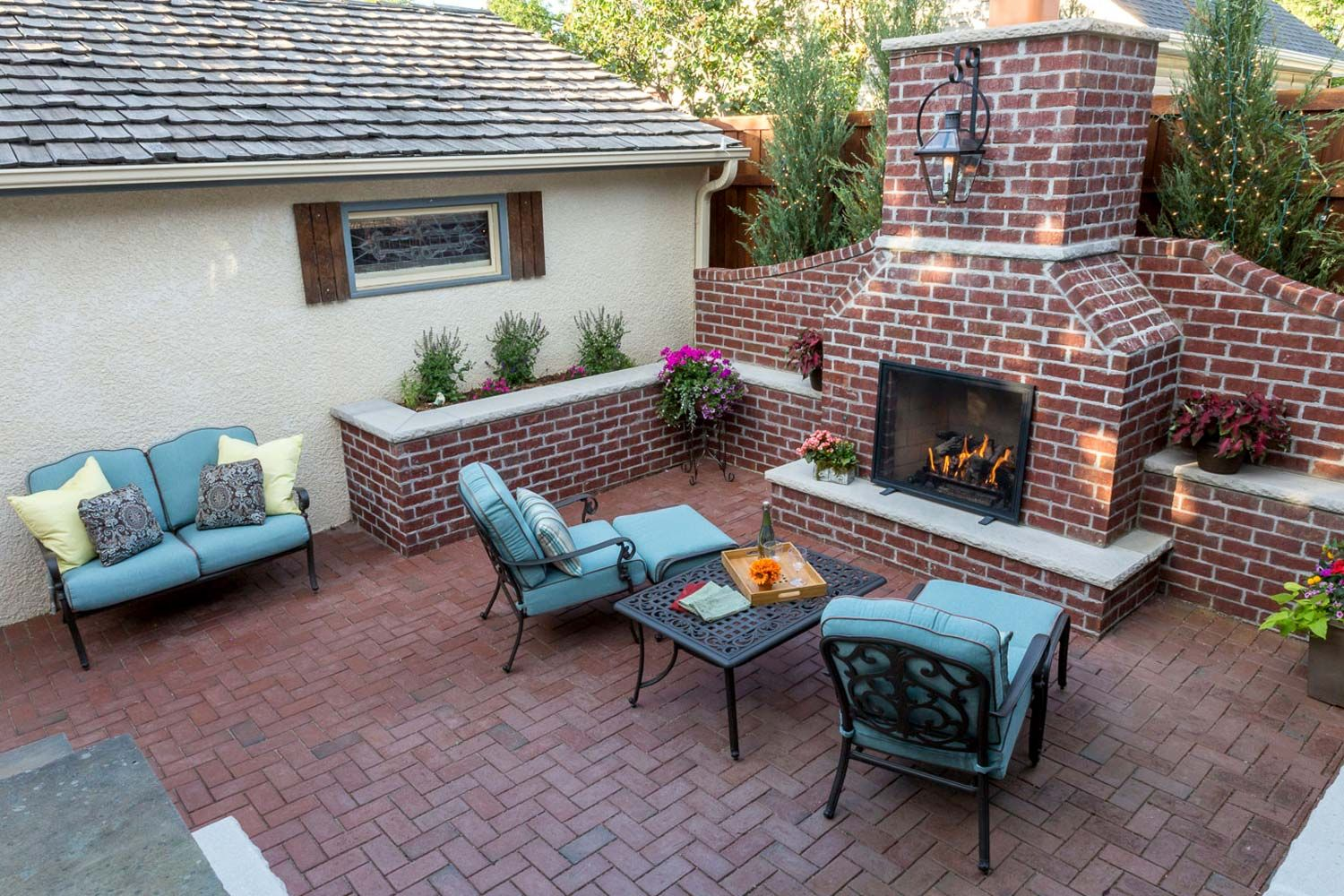 Red Brick Herringbone Paver Patio In St Paul Lights In Trees Behind Fireplace Outdoor Fireplace Patio Backyard Patio Concrete Backyard