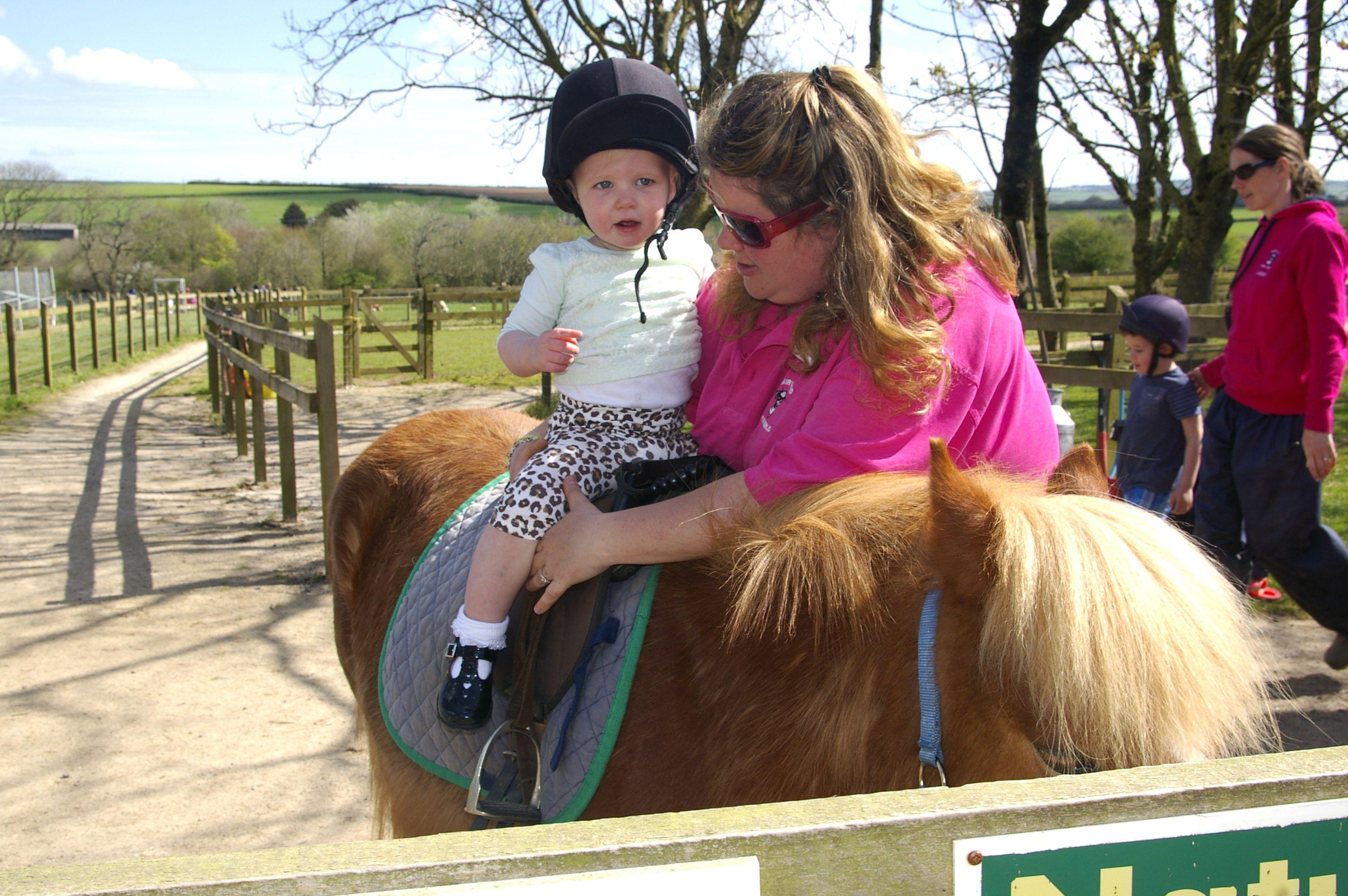 Sienna's first pony ride! #parkdean #britishholiday #whiteacres #dairyland