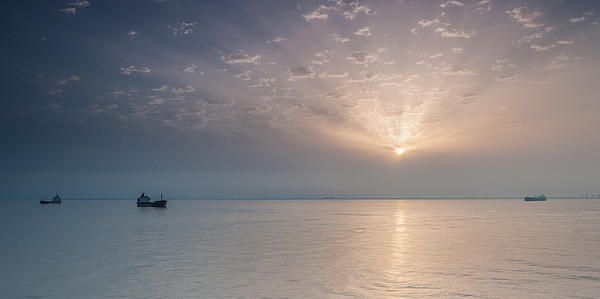 Greeting cards, canvases and prints. Starting at $6.95. Copyright: Sergey Simanovsky #landscape #seascape #sea #water #sun #sunrise #sky #clouds #cloud #ship #ships #reflection