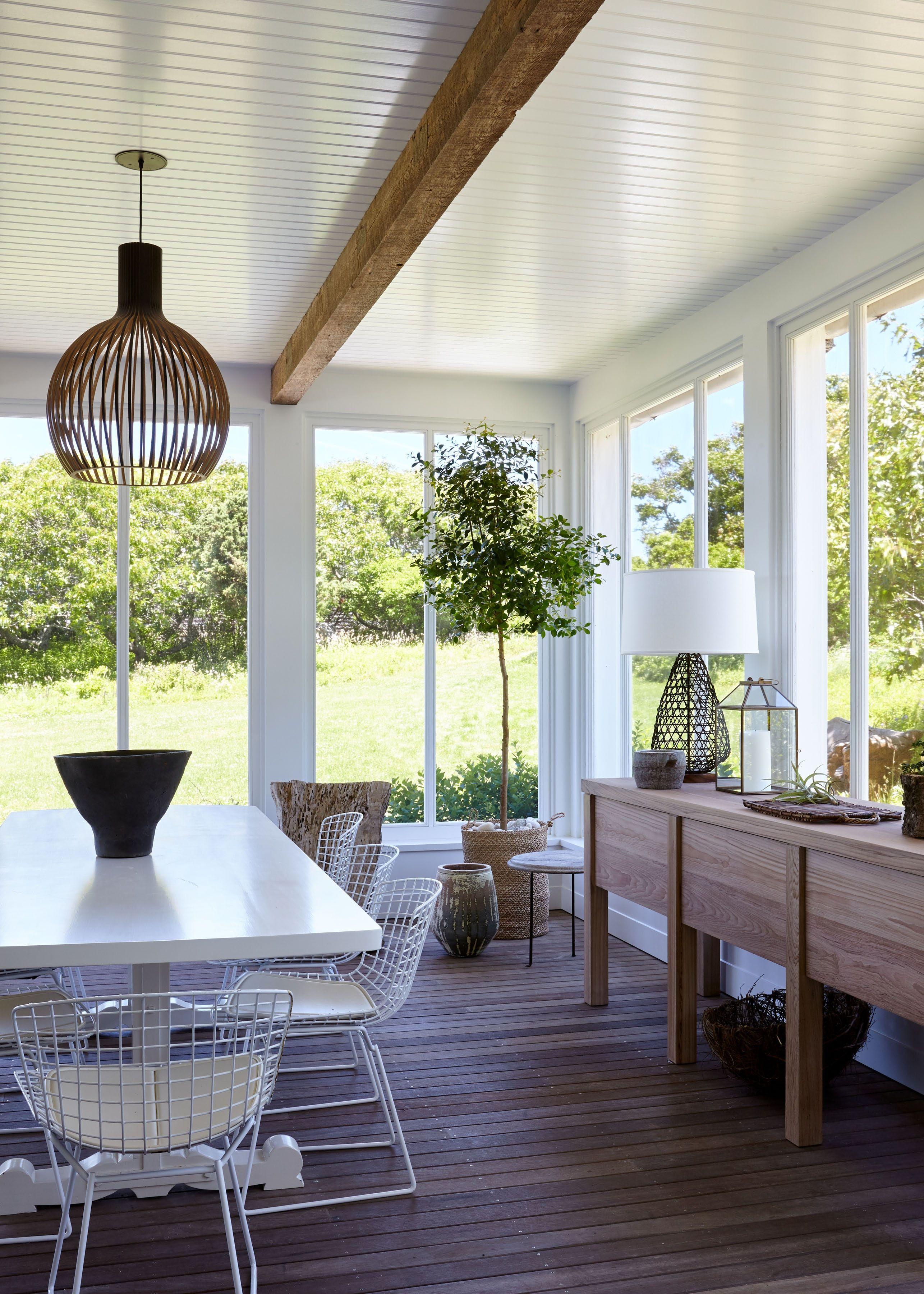 Coastal new england screened porch dining area interior