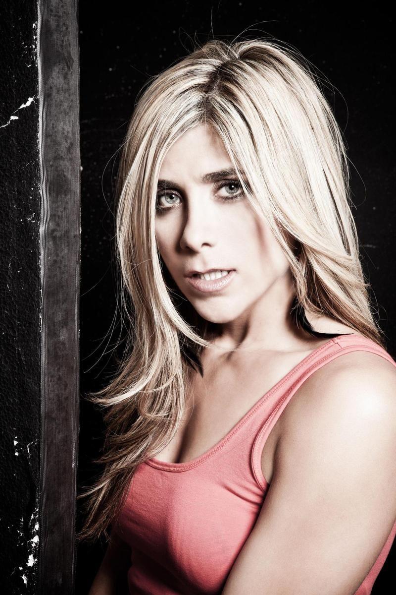 Griechisches blondes reifes Fernsehen im Zapfen