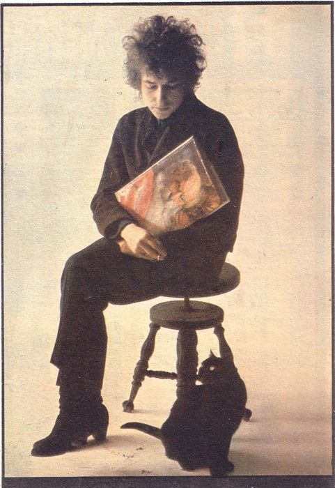 This magical black Cat sits like a Muse, for a Photo Session with his Human, Bob Dylan.