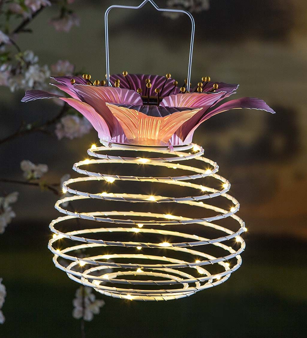 Our Hanging Spring Coil Solar Lantern With Flower Top Offers A Whimsical Way To Light Up Your Vintage Outdoor Lighting Solar Lanterns Decorative Solar Lanterns
