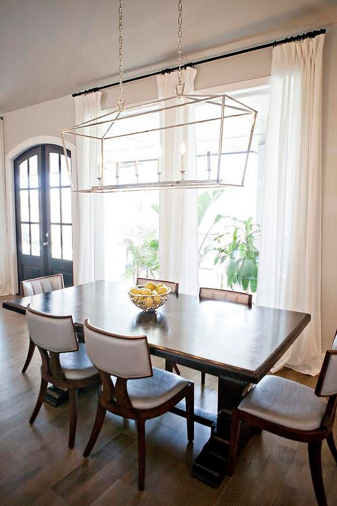 darlana linear chandelier. the chandelier hanging over the table