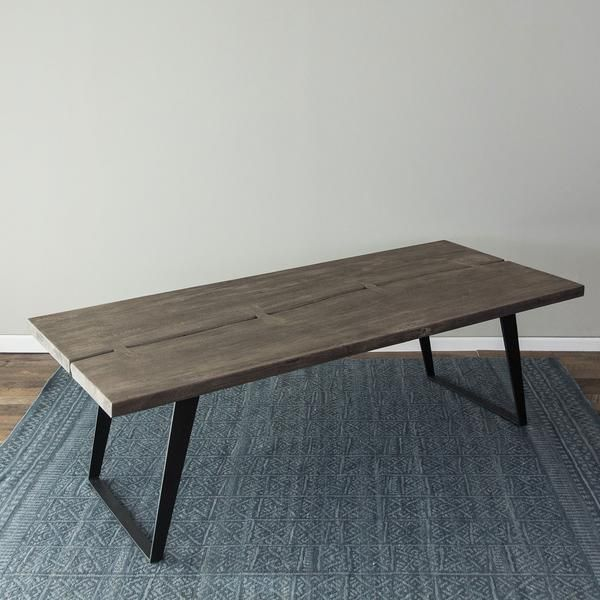 """Two thick live-edge wood slabs are separated by a thin, meandering ridge and held together by solid acacia butterflies. Finished with a sleek and modern iron base, The Nature Line dining table sets the scene for a quiet meal at home or a big dinner party! Dimensions: L: 92"""" W: 42"""" H: 30""""Materials: Acacia Wood, IronColors: Sandblast Grey, Black"""