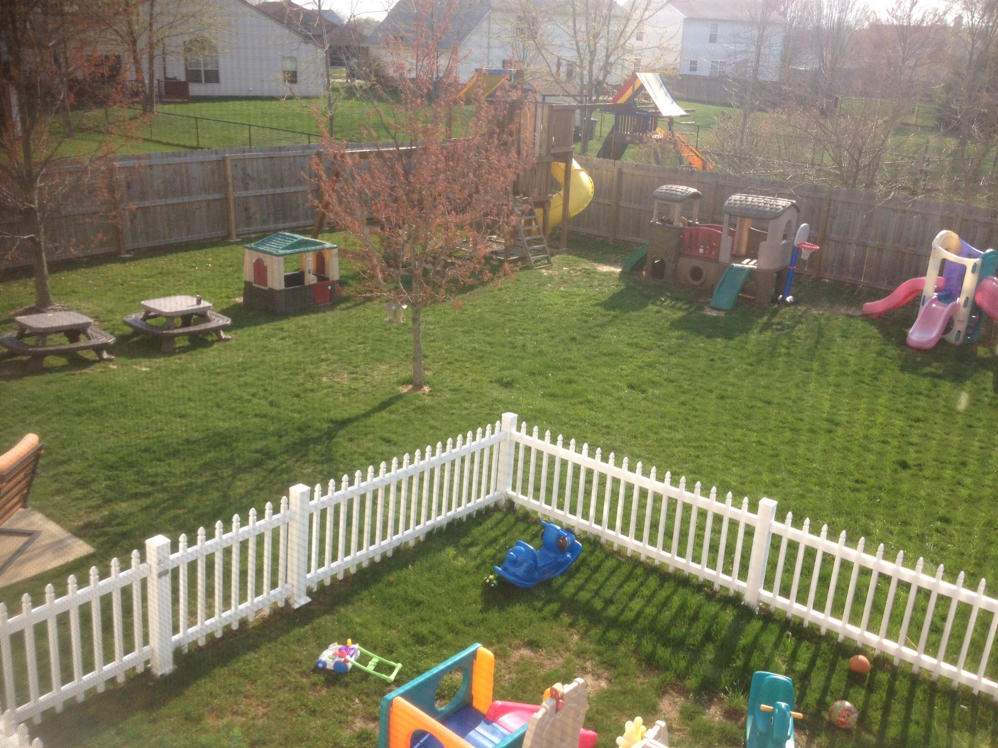 Outdoors play areas...white fence keeps toddlers in