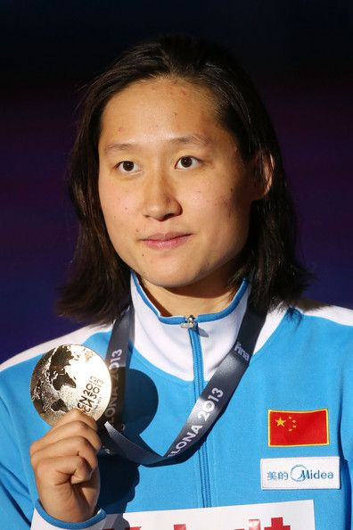 Gold medal winner Zige Liu of China celebrates on the podium after the Swimming Women's Butterfly 200m Final on day thirteen of the 15th FINA World Championships at Palau Sant Jordi on August 1, 2013 in Barcelona, Spain.