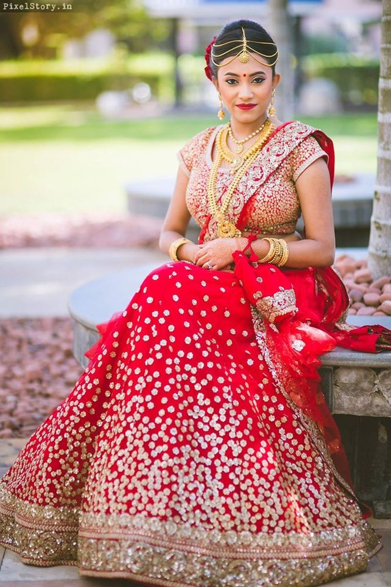 Bridal red Lehenga with flare and a gold border with embroidery ...