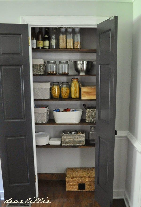 The reasoning for re-painting all the trim in this room (our eat-in-kitchen and family room) white and the doors black pro... #graycabinets