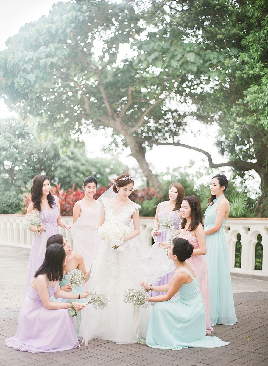 0824b89f641 Bridesmaids in pastel dresses    A Kaleidoscope of Pastels  Johann and  Emily s Wedding  Facebook and Instagram  The Wedding Scoop