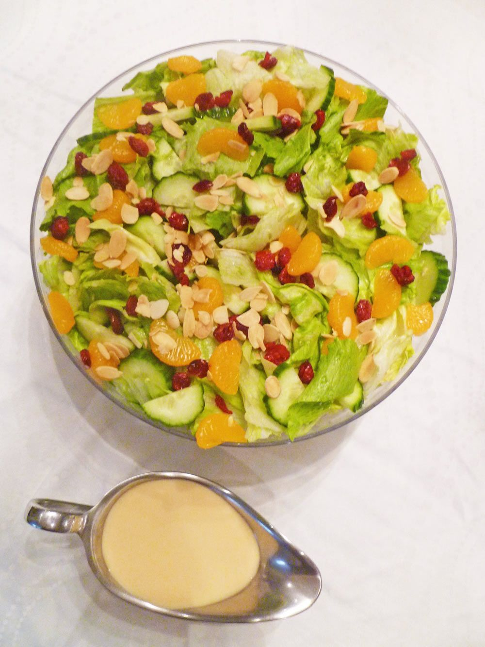 Crisp lettuce with sweet and creamy orange dressing, mandarin orange slices, cucumbers, dried cranberries and roasted almonds. Creamy Orange Salad ...
