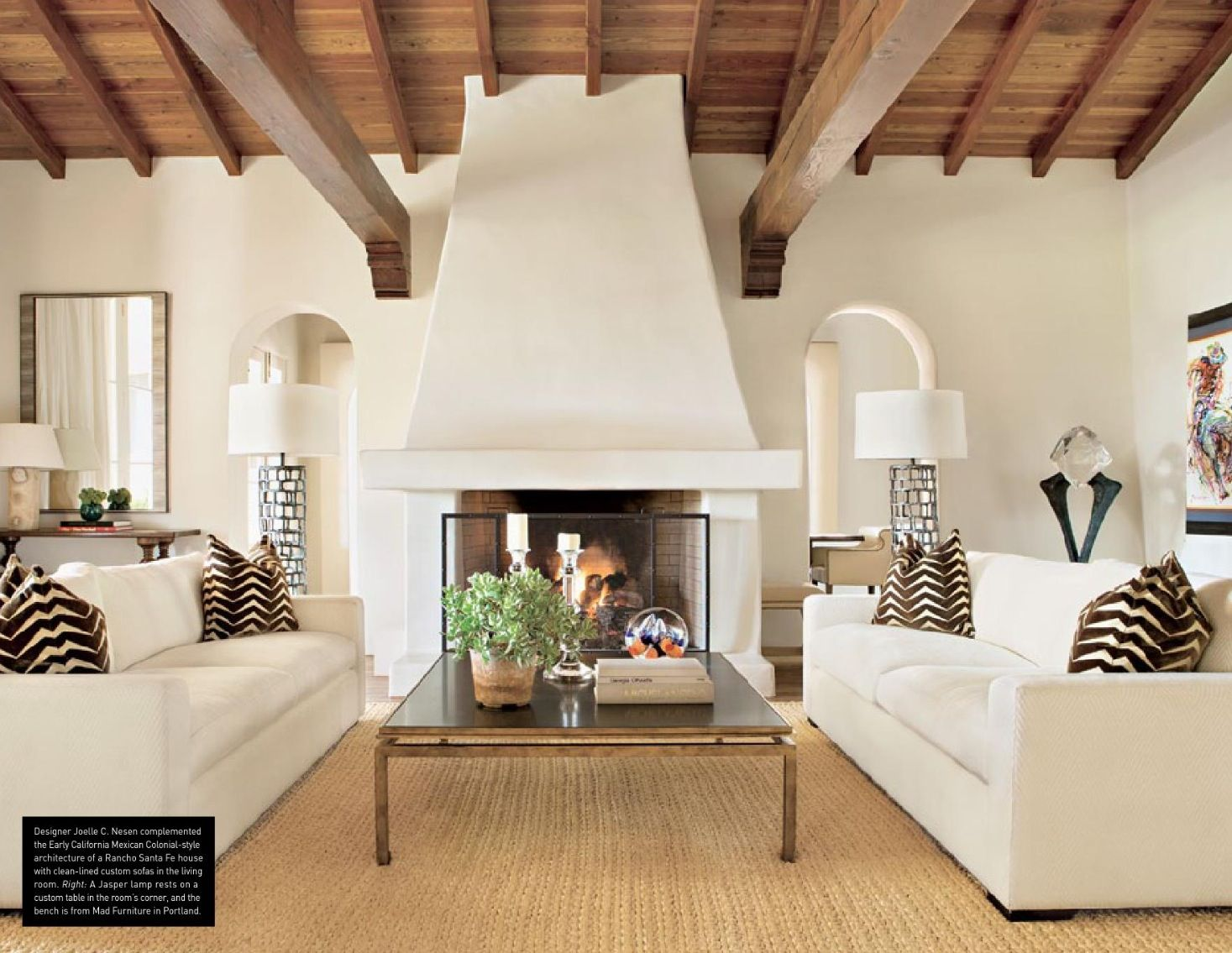 Fireplace design...add a wooden mantle that matches the wooden beams ...