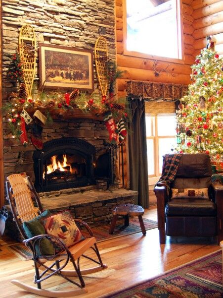 Rocking Chair And Arm Chair Small Table And Rug By Fireplace Christmas Fireplace Log Cabin Christmas Cabin Christmas