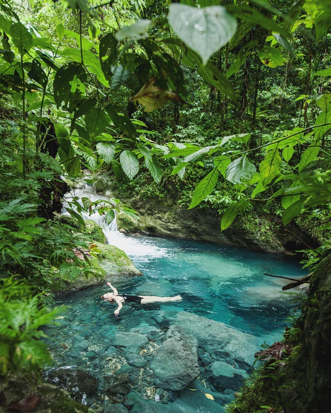 Wishing you a relaxing Good Friday from Port Antonio Jamaica where the Drivers River forms perfect turquoise swimming holes under the emerald canopies of the John Crow Mountains. #surroundmewithwater   by Islands' photographer @zachstovallphoto on assignment in Portland Parish Jamaica.  by islandsmagazine
