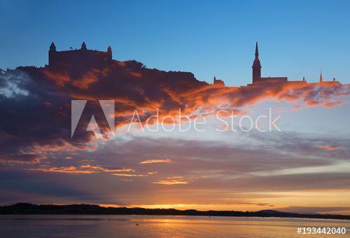 Stock Image: The symbolic silhouette of Bratislava in sanstet clouds.