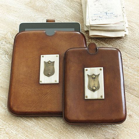 This iPad and e-reader case has a look that's wonderfully old school. This hand tooled leather sleeve is made of stained distressed leather with brass shield accents. Add a single letter monogram to make this heirloom gift even more special.