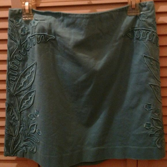 Cache Skirt Lite blue with flowers, and leaf design with sequins. Has zipper in the back. Beautiful little skirt. Could be worn with Heels, Boot's, and Sandals. Cache Skirts Midi