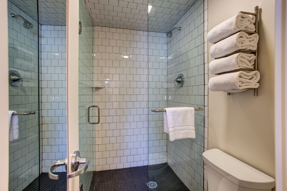 Hotel Durant - white tile w/gray grount & black matte penny tile ...