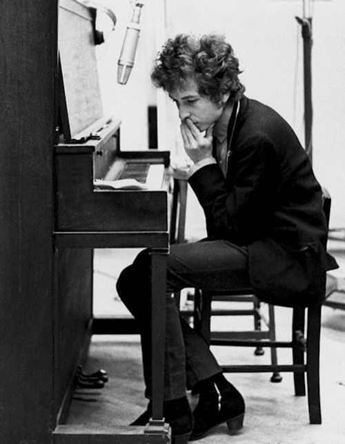 Bob Dylan - Listened to him all the time as a teenager and even copied his fashion style.