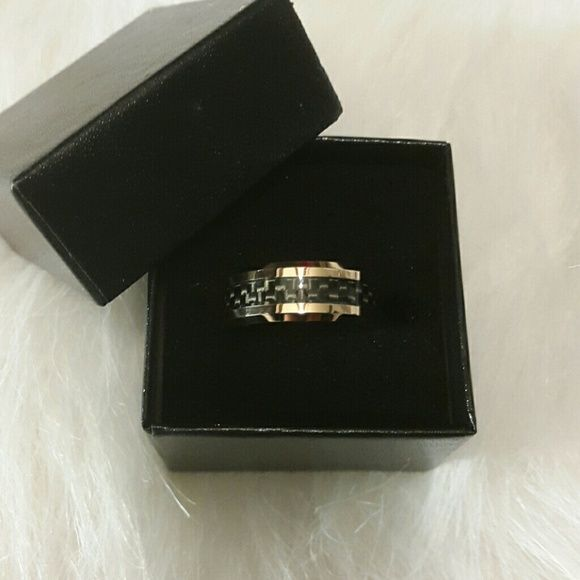 Men's rose gold carbon fiber inlay ring. Brand new in box 18k rose gold ring,  size 7!  The ring didn't fit him.  :( It honestly doesn't have to be a men's ring.  It's cute for  ladies too! (: Jewelry Rings