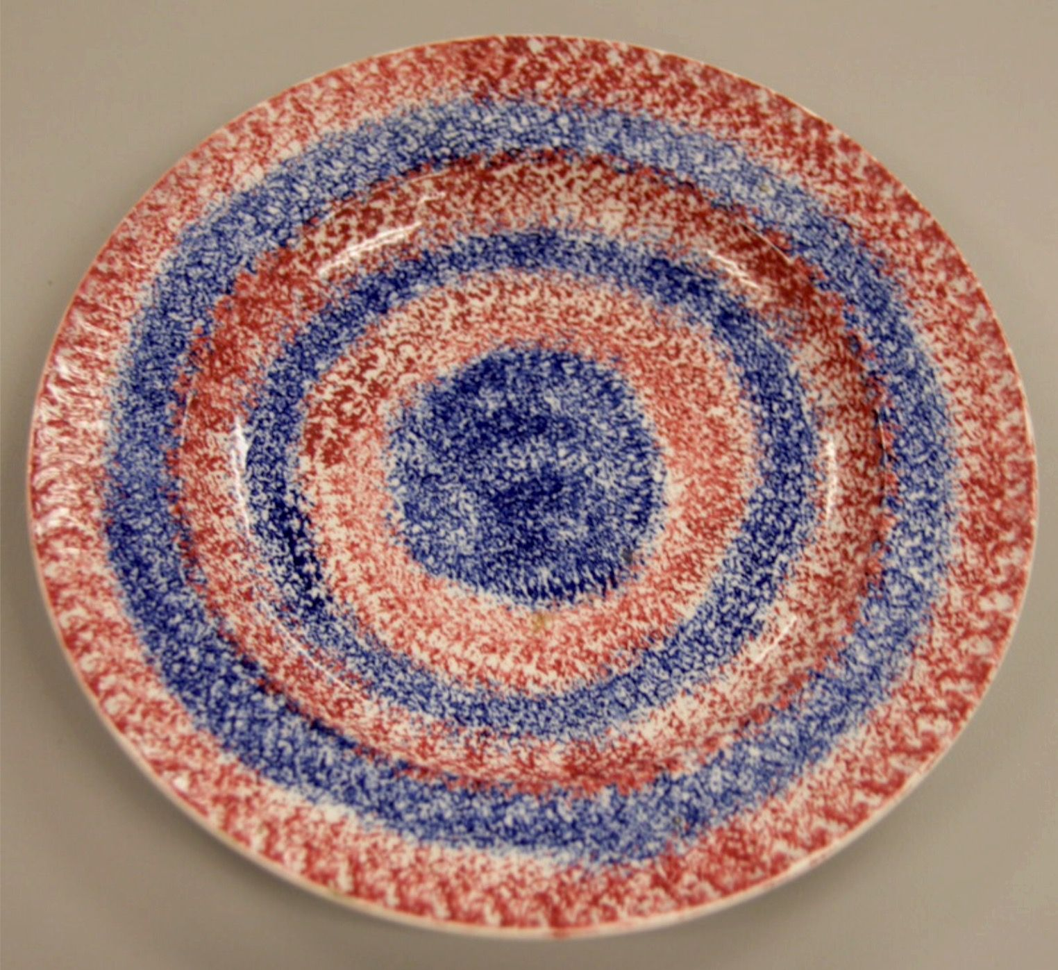 Two Color Red And Blue Rainbow Spatterware 8 1 4 Inch Plate In A Bulls Eye Pattern In