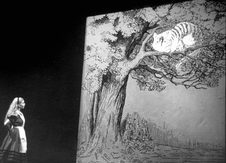 <b>Caption from LIFE.</b> The Cheshire Cat appears mysteriously in a tree and grins down at Alice.