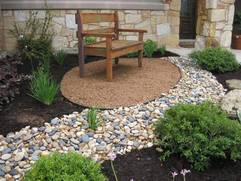 river stone flower beds