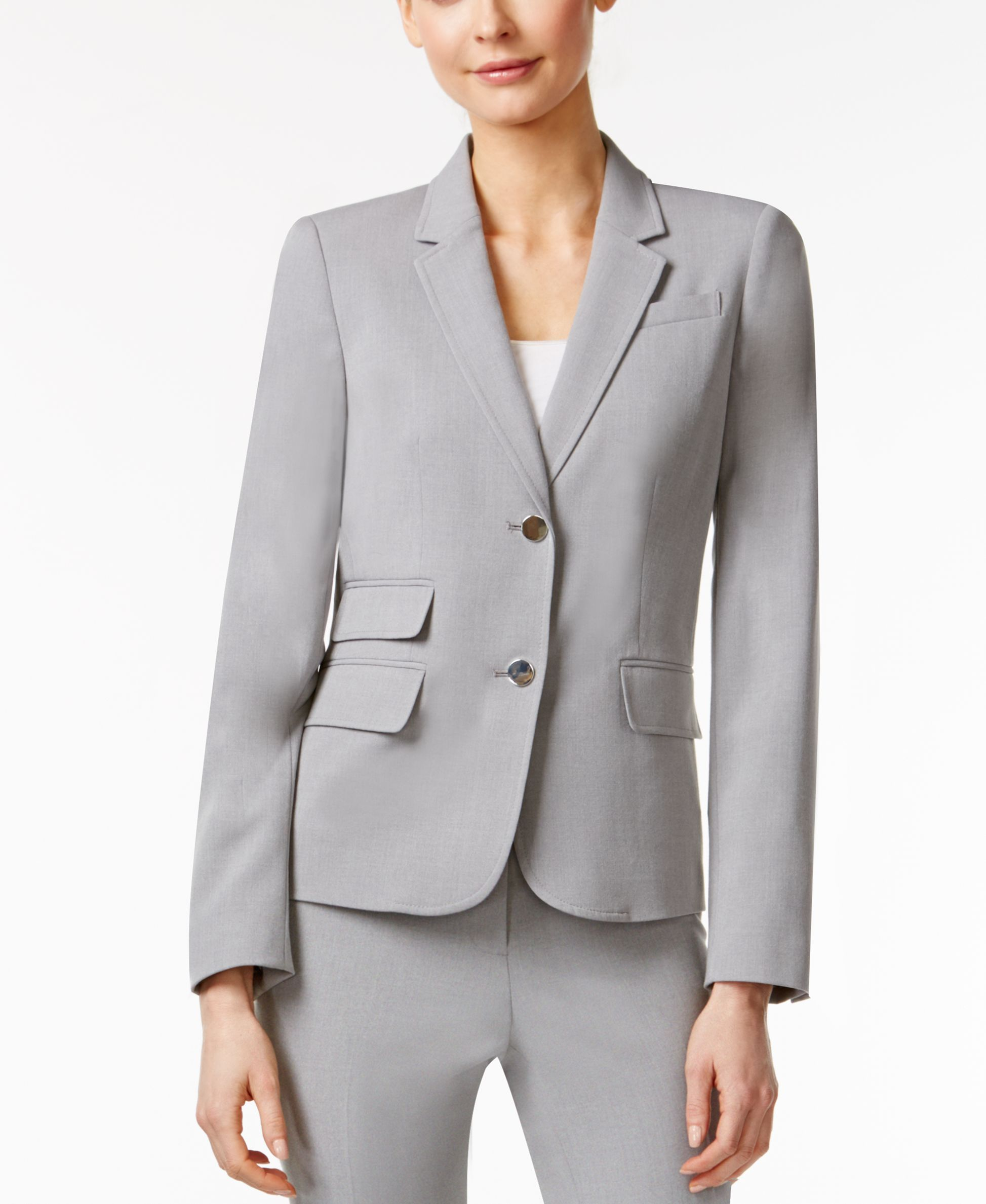 0b083e87cee99 Get classic and polished office appeal in this Calvin Klein blazer.    Polyester  lining  polyester rayon spandex   Dry clean   Imported   Two  button ...