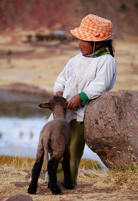 'Sillustani Girl with hat and lamb'. A little girl with a lamb in Sillustani, a pre-Incan burial ground on the shores of Lake Umayo near Puno in Peru.  © RicardMN Photography