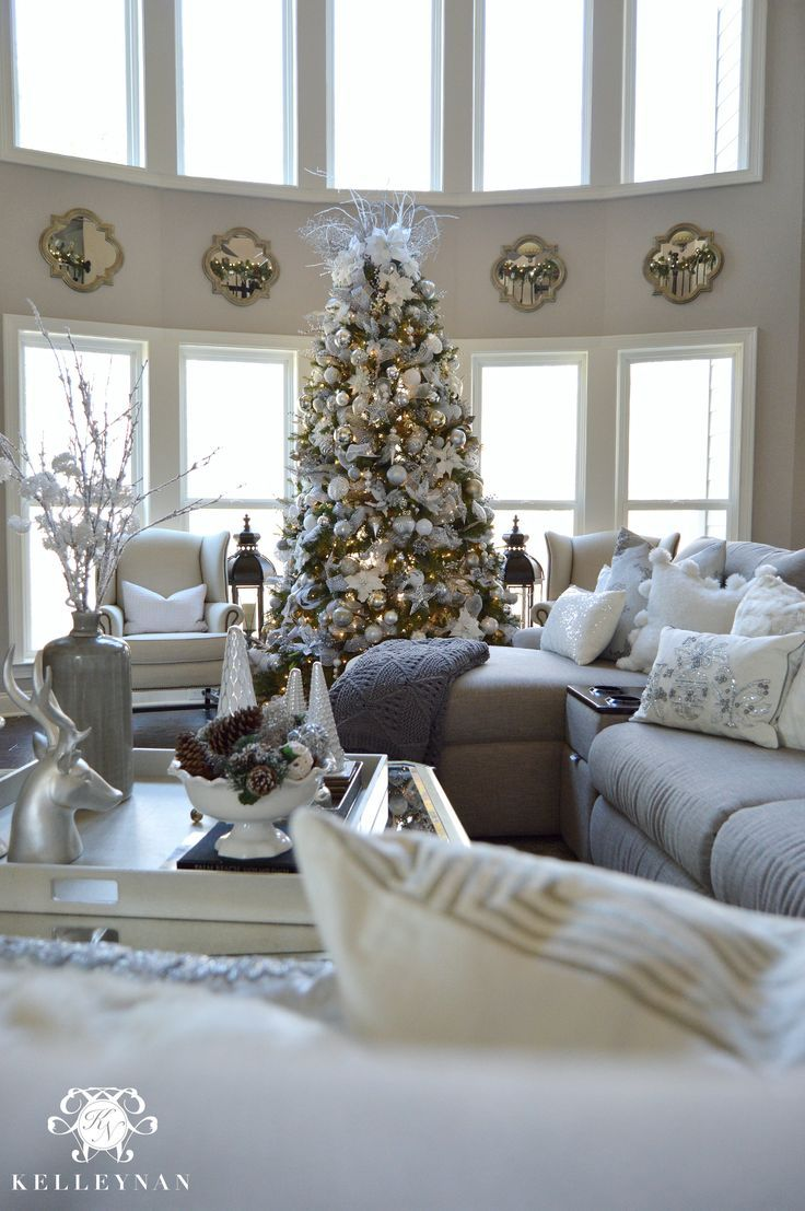 Two Story Living Room With Neutral Silver And Gold Christmas Decor And Large Silver A Christmas Decorations Living Room Christmas Living Rooms Christmas Room