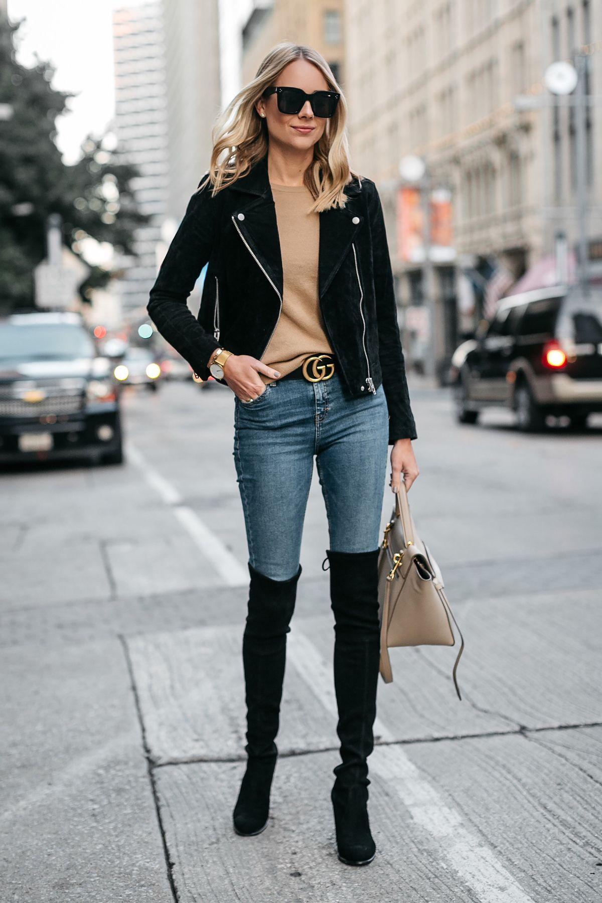 2185e5d35a5b Blonde Woman Wearing Black Suede Moto Jacket Camel Sweater Denim Skinny  Jeans Stuart Weitzman Over-the-Knee boots Gucci Marmont Belt Fashion  Jackson Dallas ...