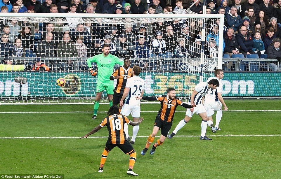 The Hull forward turns away in celebration as disappointment spreads over the faces of the West Brom players
