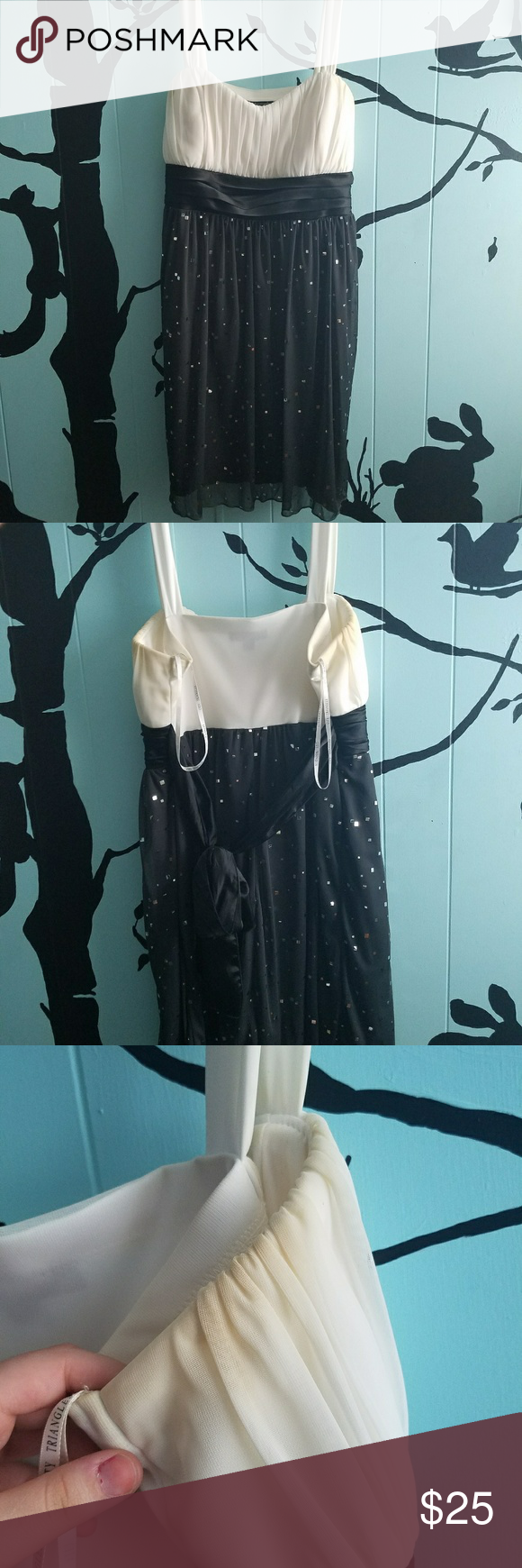Black and grey strapped formal dress It has sweat stains in the armpit area on both sides of the dress but nothing a good wash or dry cleaner couldn't fix. The dress is on good shape and has no rips in it. The dress goes to about the knee length. City Triangles Dresses Prom
