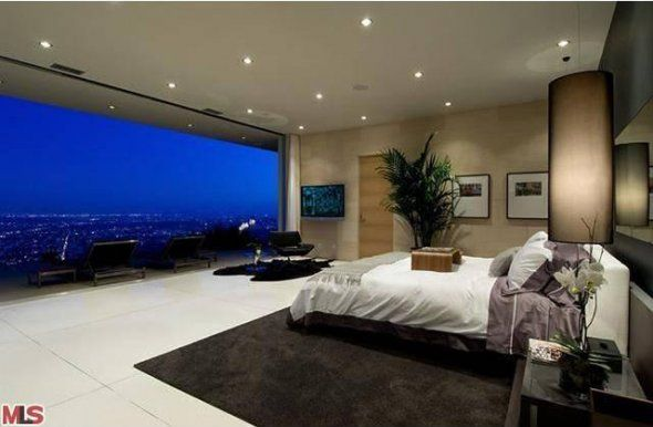 The master bedroom has a floor-to-ceiling wall of windows, providing a great view of the city when you wake up.