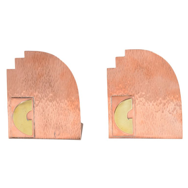 Art Deco Bookends with Geometric Brass Relief Detail   From a unique collection of antique and modern bookends at https://www.1stdibs.com/furniture/more-furniture-collectibles/bookends/
