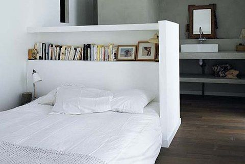 Bookshelf, headboard, wall, space-divider, and well designed. Love it.