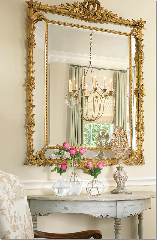 The Dining Room Chandelier Is Reflected In The Mirror Above An Adorable Decorative Mirrors Dining Room Design Ideas