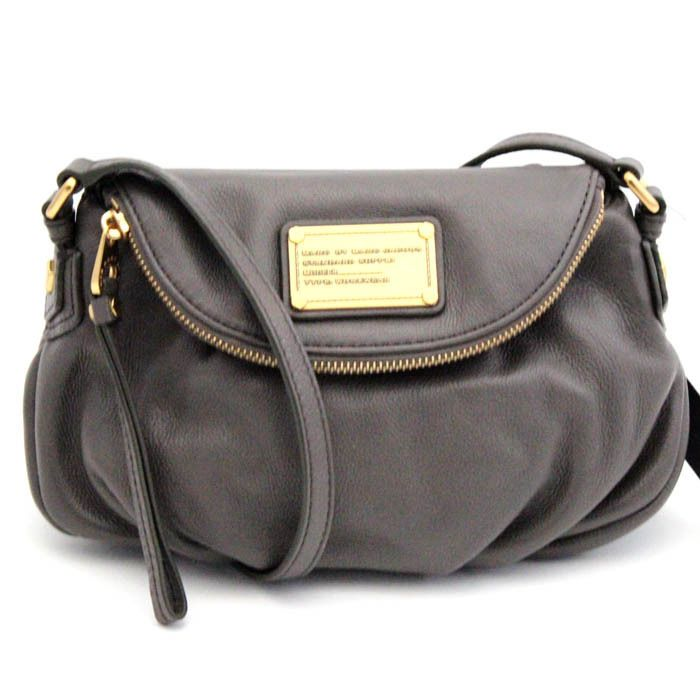 177345d807d7 Ensure you have all of your essentials close at hand with this Marc By Marc  Jacobs Classic Q Faded Aluminum Mini Natasha Handbag.