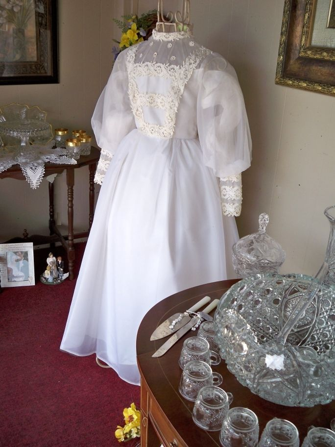 This gorgeous, vintage wedding dress can be purchased in Treasure Cove Mall's wedding window!