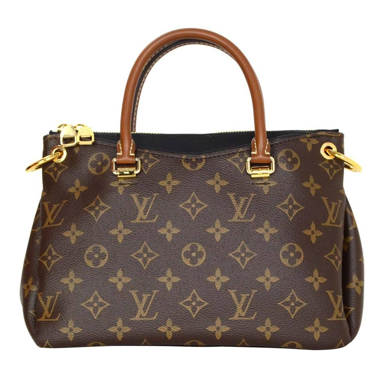 34805219d738 For Sale on - Louis Vuitton Monogram Canvas   Black Leather Pallas BB Bag  Features optional shoulder crossbody strap Made In  U.