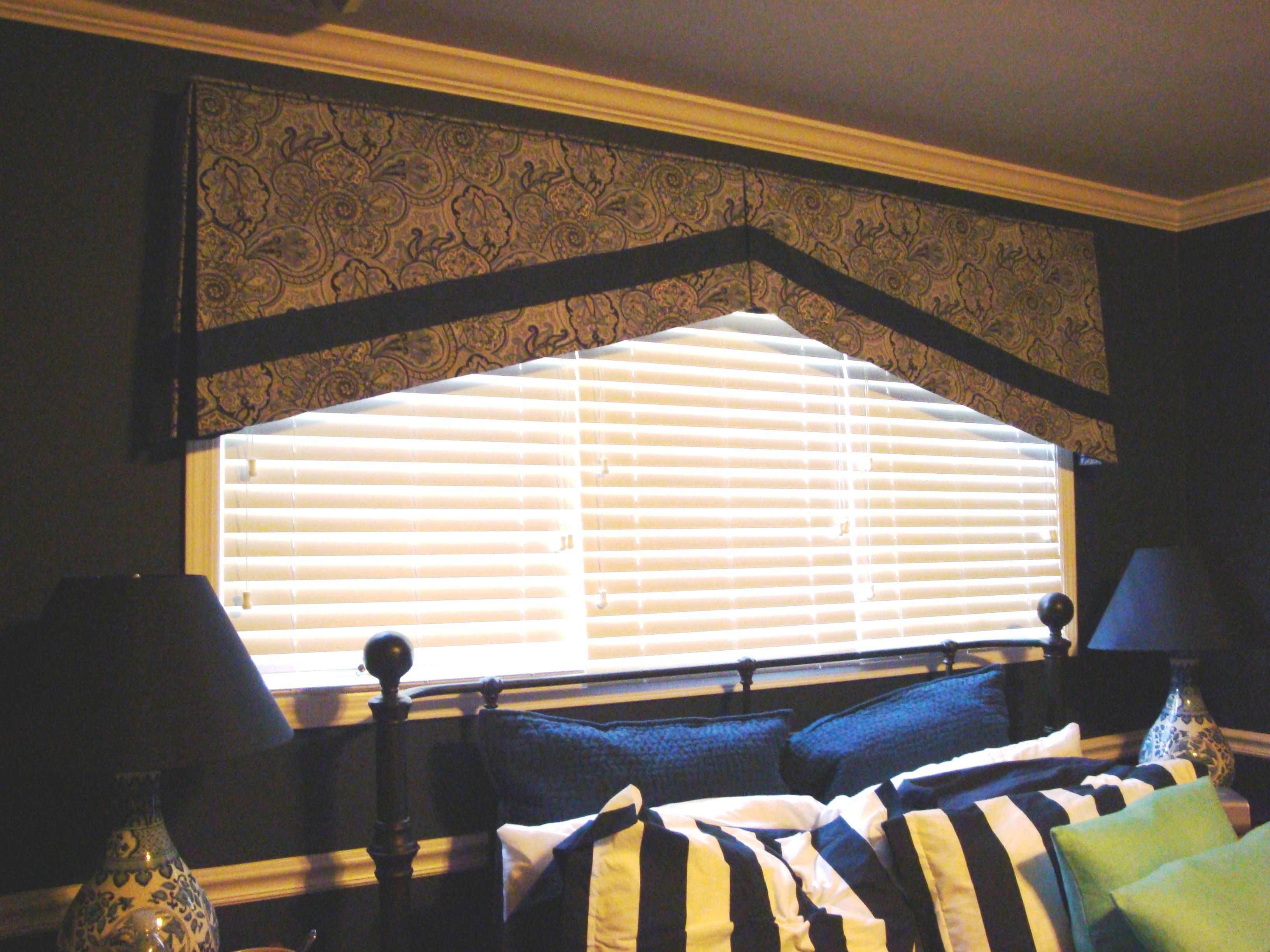 A dark place for sleeping with an angle for detail by Soulscape Interiors, Inc.