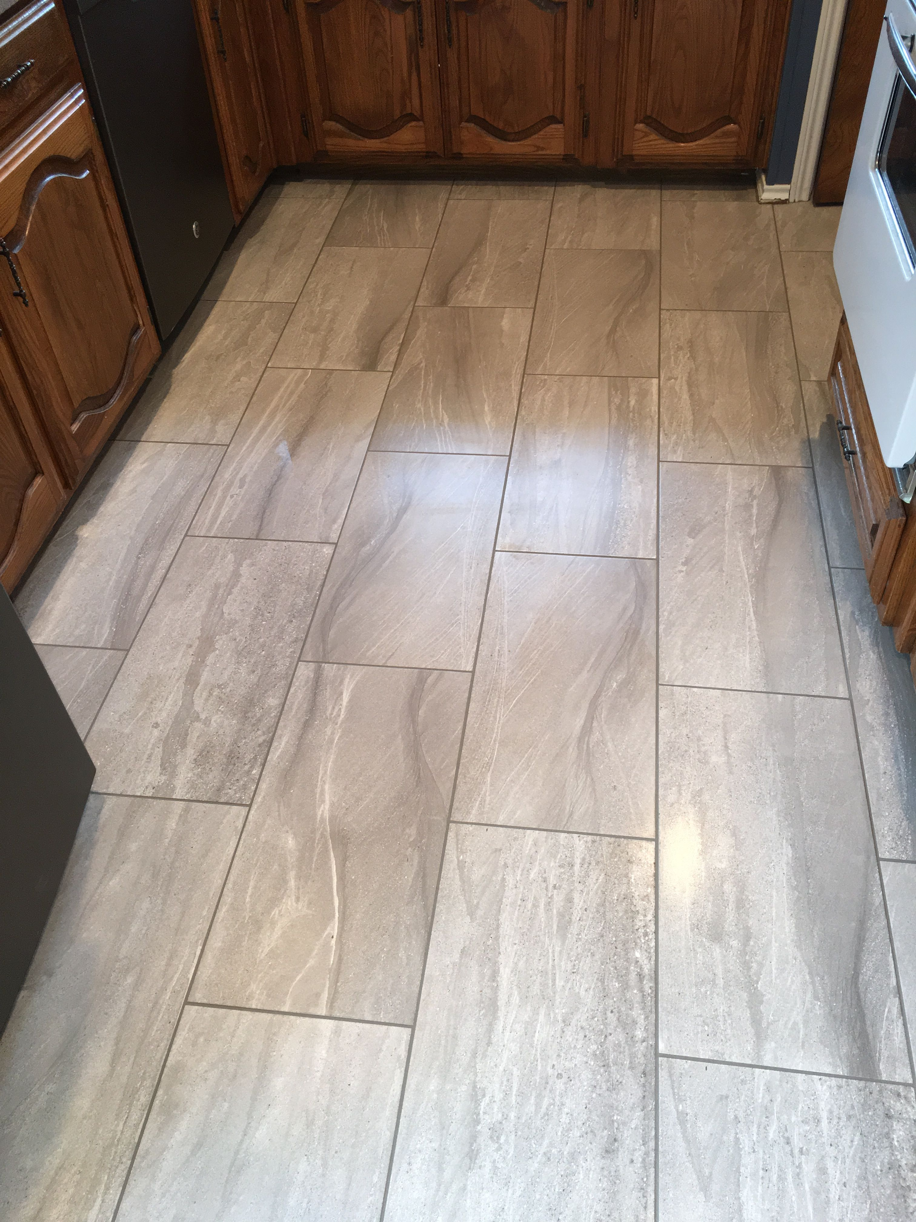 Earthwerks 12x24 Linden Stone Color Light Gray Laud On A Brick