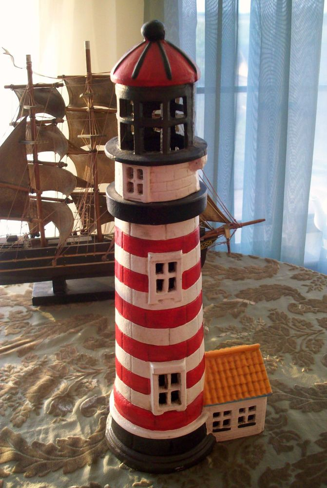 tall cast iron lighthouse 16 3 4 h design black white