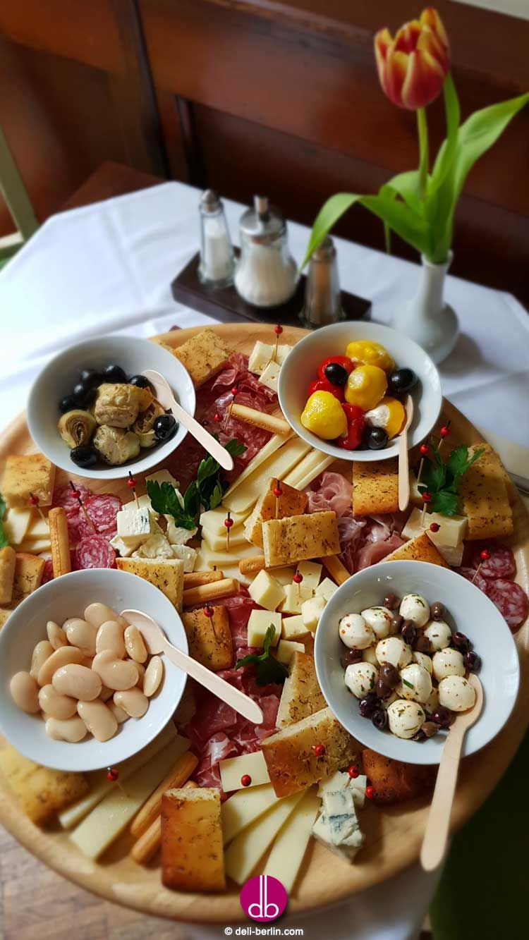 Photo of perfect antipasti appetizer cheese platter